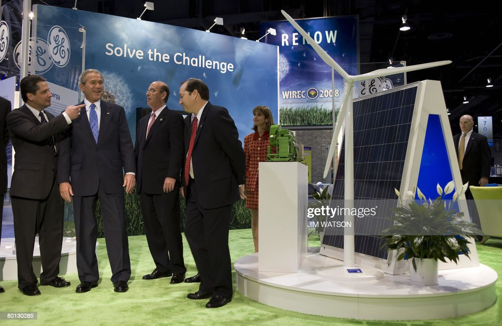 US President George W. Bush (2nd L) looks over General Electrics' Wind Power display during the Washington International Renewable Energy Conference at the Washington Cenvention Center in Washington, DC, March 05, 2008. AFP PHOTO/Jim WATSON