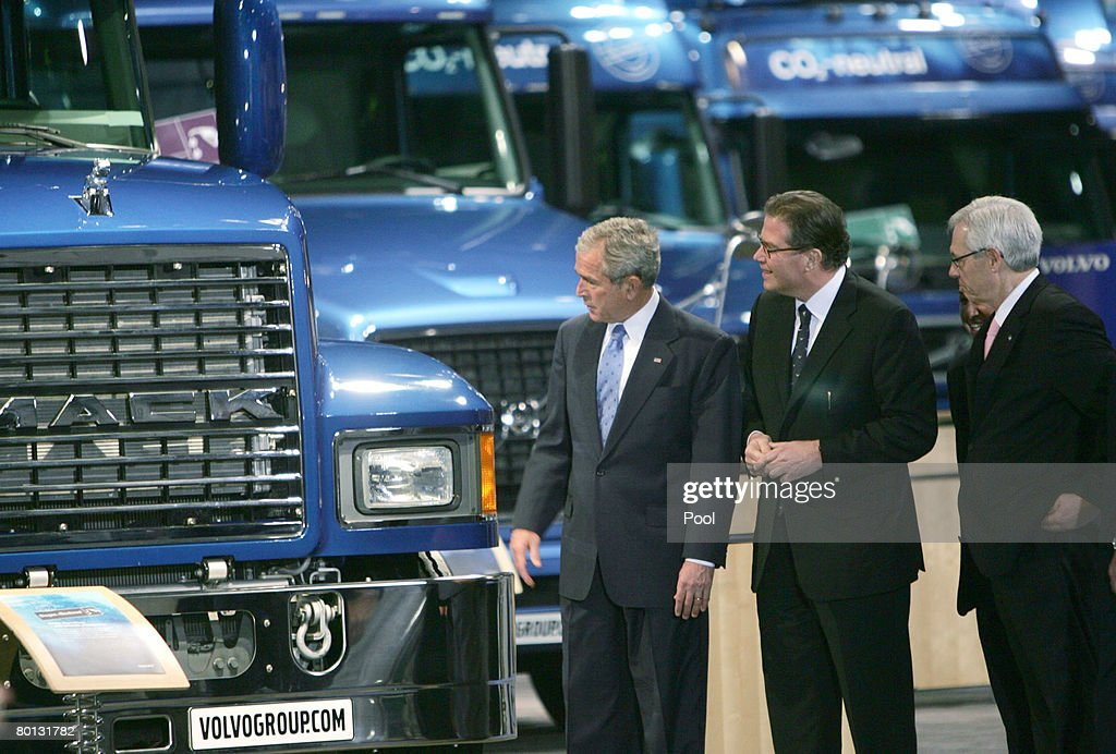 U.S. President George W. Bush (L) looks The Volvo Truck CO Neutral exhibit at the International Renewable Energy Conference March 5, 2008 in Washington, DC. The confence, is hosted by the U.S. Govenment and and sponsored by industry leaders including General Motors, British Petroleum and General Electric.