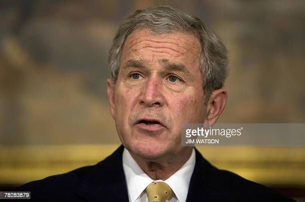 US President George W Bush makes a statement on housing with US Treasury Secretary Henry Paulson in the Roosevelt Room of the White House in...
