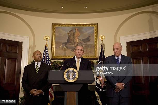 US President George W Bush makes a statement on housing with US Treasury Secretary Henry Paulson and US Housing and Urban Development Secretary...