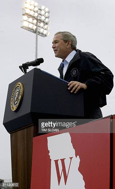 President George W Bush makes remarks to supporters during a campaign rally speech at an outdoor baseball stadium 30 July 2004 in Springfield...