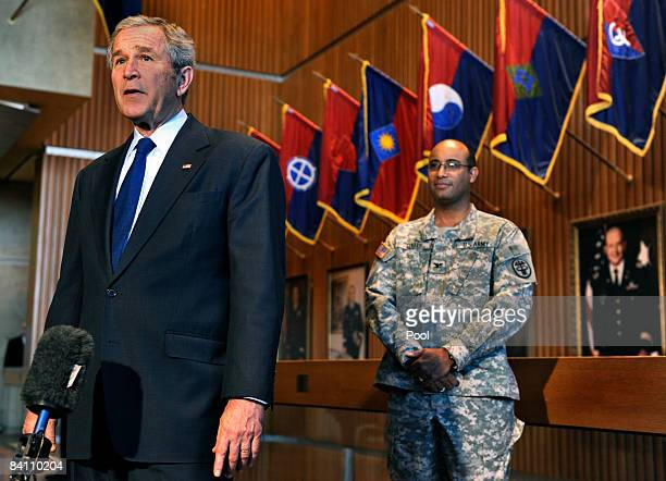 S President George W Bush makes remarks to the press in front of US Army Col Norvell V Coots commander of Walter Reed Army Medical center December 22...
