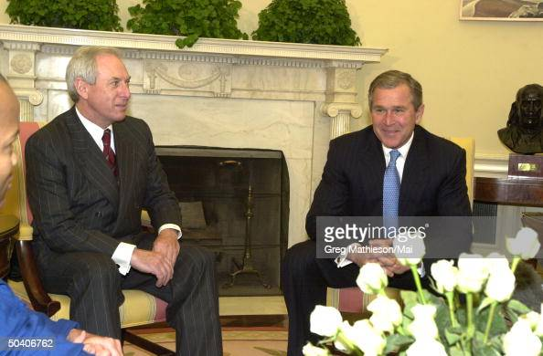 Daniel S. Goldin;George W. Bush Pictures   Getty Images