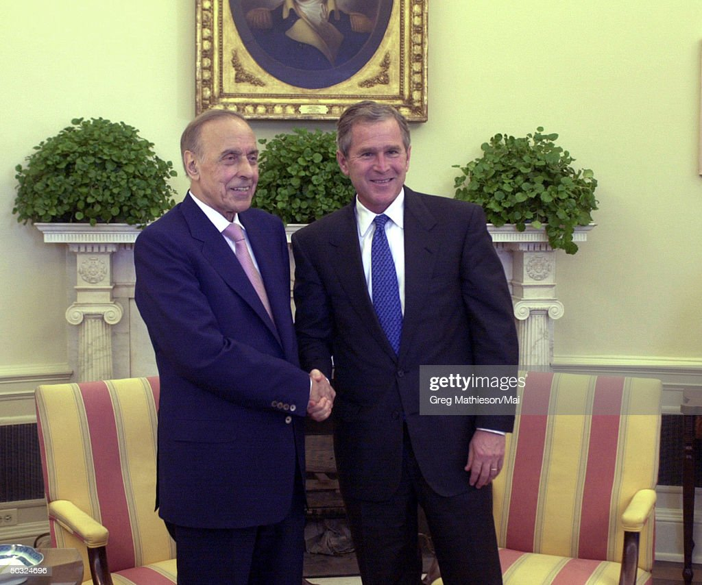 President George W. Bush (R) meeting with Azerbaijan President Geidar Aliev during a working visit in the Oval Office of the White House.
