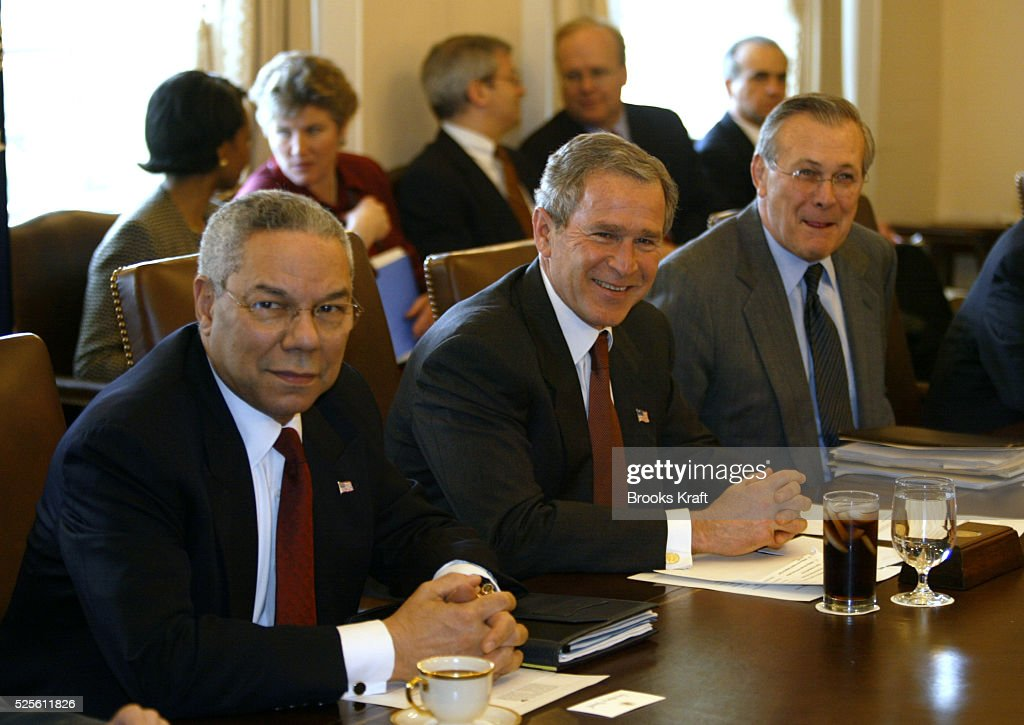 President George W. Bush (center) meets with his cabinet at the White House, including Secretary of State Colin Powell (left) and Secretary of Defense Donald Rumsfeld (right). Behind them is National Security Advisor Condoleezza Rice.