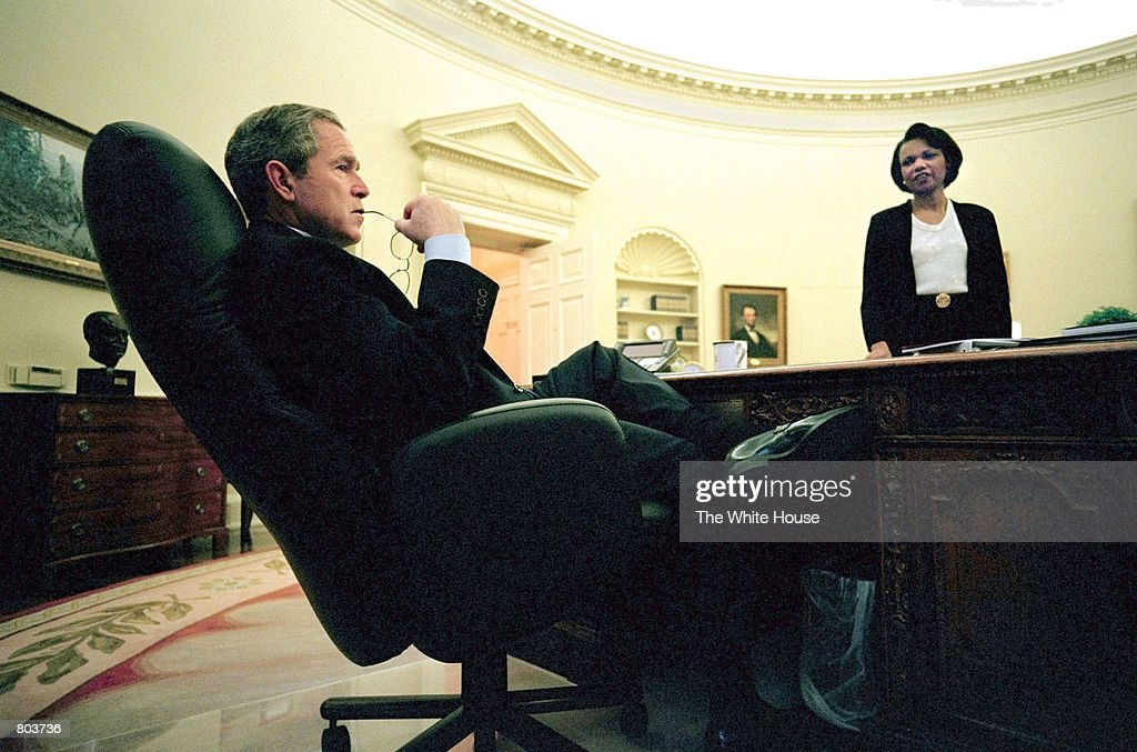President George W. Bush meets with his National Security Advisor, Condoleezza Rice in the Oval Office April 11, 2001 regarding his statement on plans for the release of United States Navy Aircraft crewmembers held in China. President Bush will celebrate his first 100 days in office April 29, 2001.