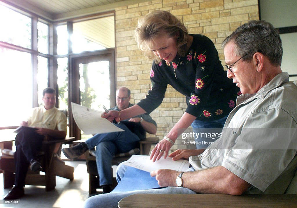 U.S. President George W. Bush meets with his senior staff August 6, 2001 at his ranch in Crawford, Texas. From left are, Steve Biegun of the national security staff, Deputy Chief of Staff Joe Hagin and staff secretary Harriet Miers.