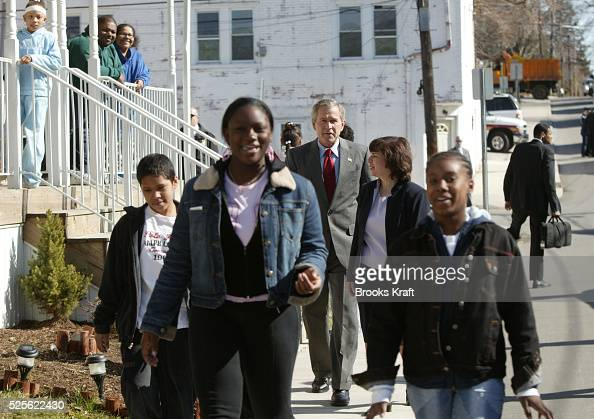President George W Bush meets with residents as he takes a tour of new homeowners' houses before holding a discussion on home ownership in Ardmore...