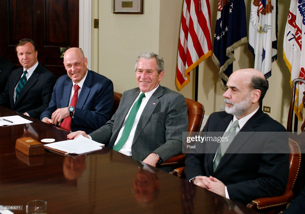 S President George W Bush meets with Securities and Exchange Commission Chairman Christopher Cox Treasury Secretary Henry Paulson and Federal Reserve...