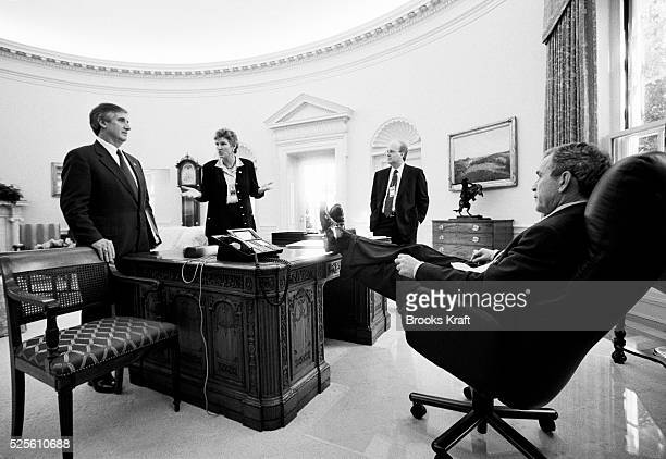 President George W Bush meets with senior staff in the Oval Office to discuss policy Left to right Chief of Staff Andrew Card Advisor Karen Hughes...