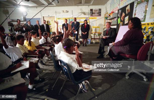 President George W Bush participates in a reading demonstration the morning of Tuesday Sept 11 at Emma E Booker Elementary School in Sarasota Fla...
