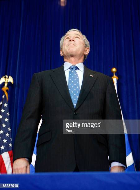 US President George W Bush pauses as he speaks on aviation congestion and transportation safety at the US Department of Transportation on November 18...