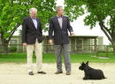S President George W Bush points to his dog Barney as Australian Prime Minister John Howard looks on after they attended a media conference in front...