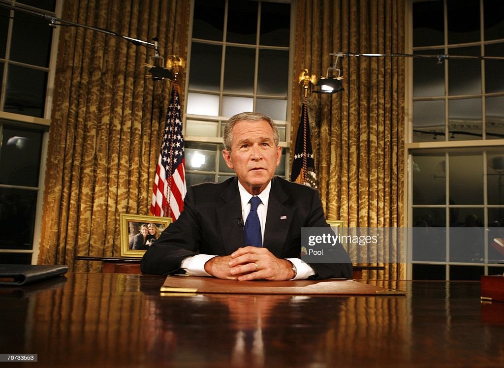 President <a gi-track='captionPersonalityLinkClicked' href=/galleries/search?phrase=George+W.+Bush&family=editorial&specificpeople=122011 ng-click='$event.stopPropagation()'>George W. Bush</a> poses for photographers after addressing the nation on the military and political situation in Iraq from the White House September 13, 2007 in Washington, DC.