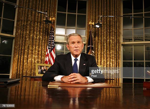 President George W Bush poses for photographers after addressing the nation on the military and political situation in Iraq from the White House...