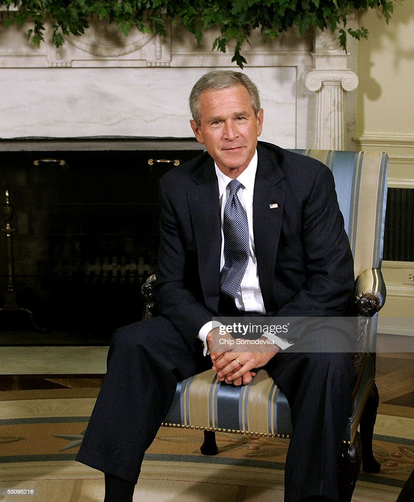 U.S. President <a gi-track='captionPersonalityLinkClicked' href=/galleries/search?phrase=George+W.+Bush&family=editorial&specificpeople=122011 ng-click='$event.stopPropagation()'>George W. Bush</a> poses for photographers in the Oval Office at the White House September 6, 2005 in Washington, DC. President Bush spoke about efforts to assist students and school districts in the Gulf Coast states who were displaced by Hurricane Katrina.