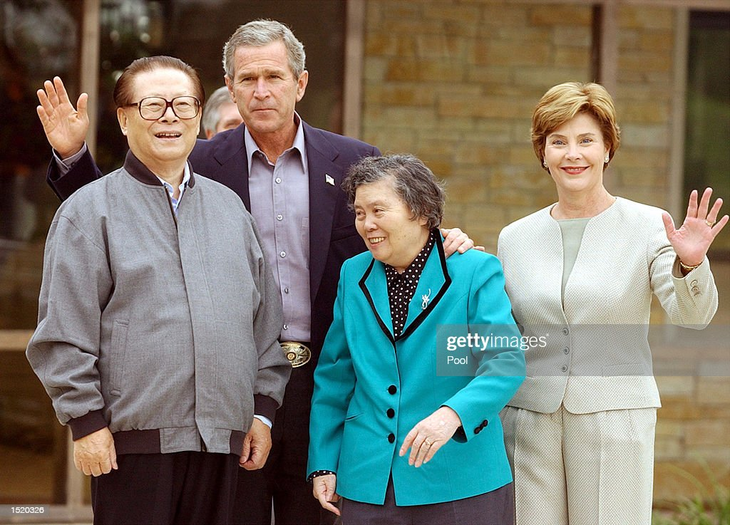 S President George W Bush poses with Chinese President Jiang Zemin and their wives Wang Yeping and Laura Bush October 25 2002 at the Bush ranch in...