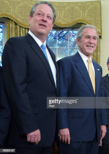 US President George W Bush poses with former US Vice President Al Gore as Bush meets with recipients of the 2007 Nobel Awards in the Oval Office at...
