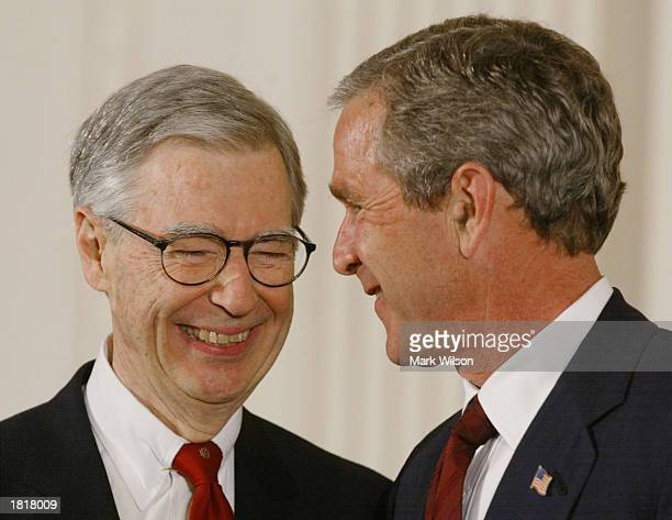 US President George W Bush presents Fred Rogers with the Presidential Medal of Freedom Award during a ceremony July 9 2002 at the White House in...