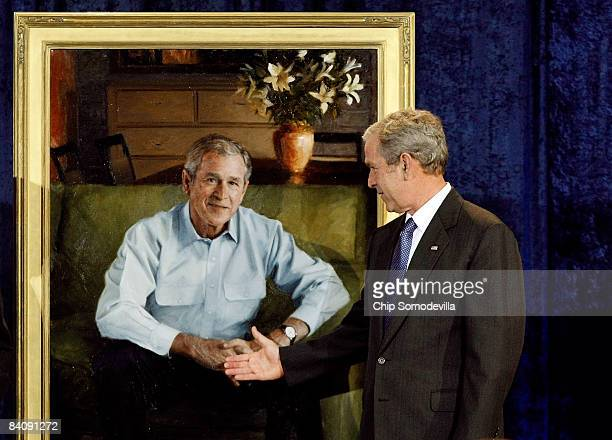 S President George W Bush pretends to shake hands with his official portrait at the National Portrait Gallery December 19 2008 in Washington DC The...