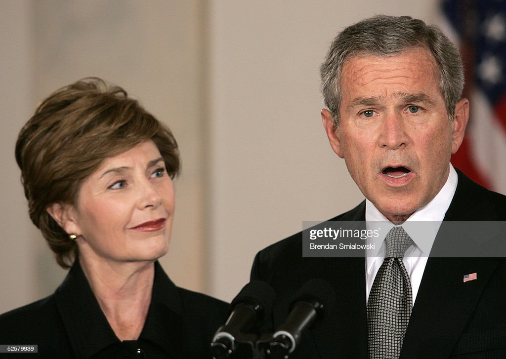US President George W. Bush reacts to the death of Pope John Paul II during a statement with First Lady Laura Bush from the White House April 2, 2005 in Washington, DC. The 84 year old Pontiff died after several weeks of deteriorating health after 26 years of leading the Catholic Church.