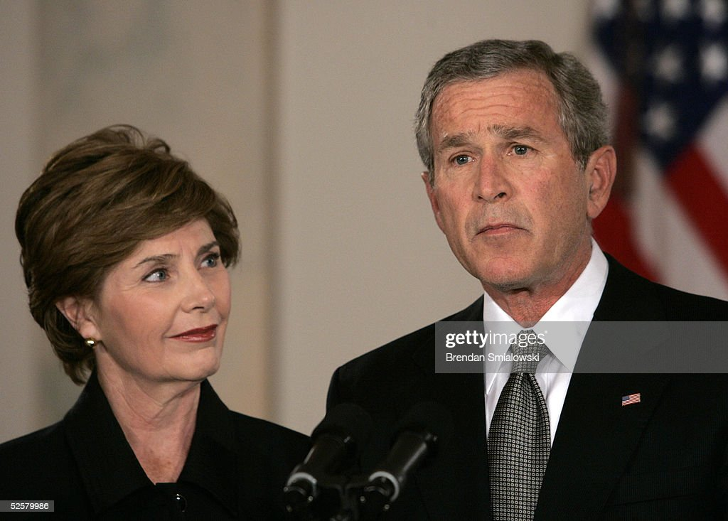 US President George W. Bush reacts to the death of Pope John Paul II during a statement with First Lady Laura Bush at the White House April 2, 2005 in Washington, DC. The 84 year old Pontiff died after several weeks of deteriorating health after 26 years of leading the Catholic Church.