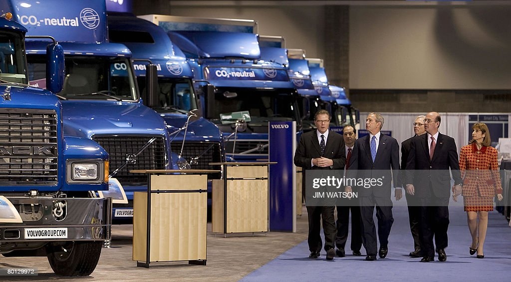 US President George W. Bush (4th R) receives a tour of Mack Hybrid Electric Vehicles while walking the trade show floor of the Washington International Renewable Energy Conference at the Washington Cenvention Center in Washington, DC, on March 05, 2008. AFP PHOTO/Jim WATSON