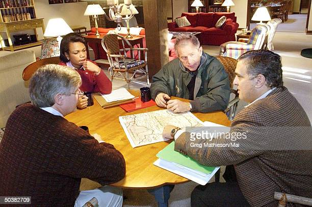 President George W Bush receiving a briefing during a meeting with CIA Director George Tenent National Security Advisor Condoleezza Rice and Chief of...