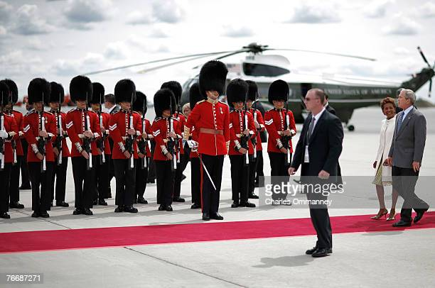 President George W Bush reviews an honour guard of Royal Canadian Mounted Police with Governor General of Canada Michaelle Jean on August 20 2007...