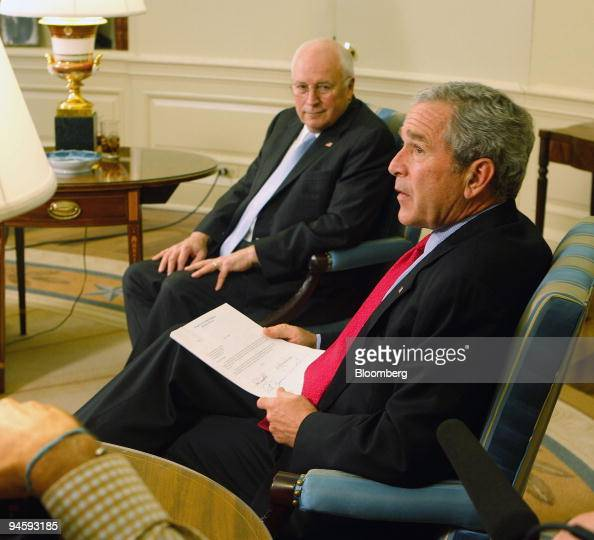 President George W Bush right and Vice President Dick Cheney chat with  Republican members of Congress