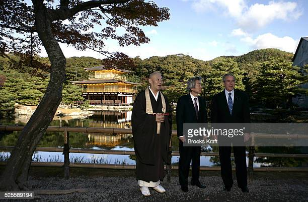 US President George W Bush right tours the Kinkakuji Temple also known as the Golden Pavilion with Japan's Prime Minister Junichiro Koizumi center...