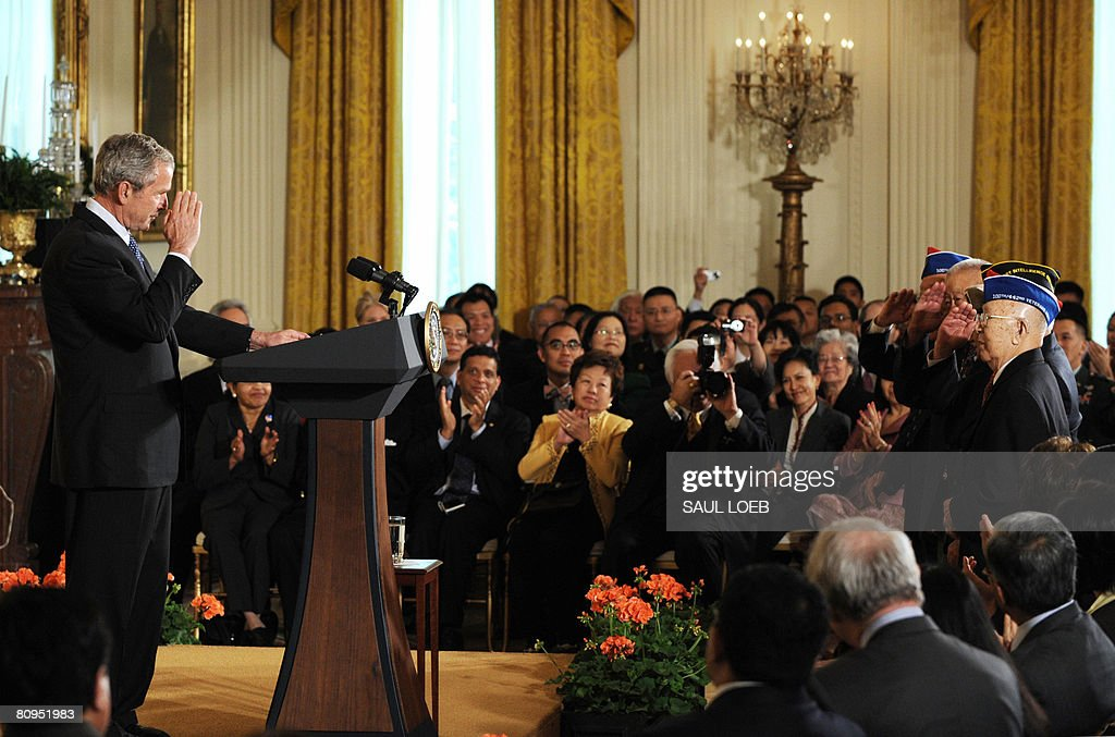 US President George W. Bush salutes a group of World War II veterans (R) during an event celebrating Asian Pacific American Heritage Month in the East Room of the White House in Washington, DC, on May 1, 2008.