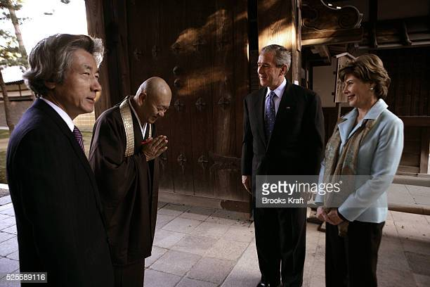 US President George W Bush second right and first lady Laura Bush arrive at the Kinkakuji Temple also known as the Golden Pavilion with Japan's Prime...