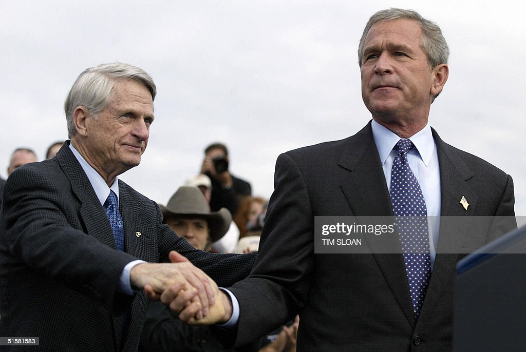 US President George W. Bush (R) shakes hands with Democratic Senator Zell Miller who is campaigning for the President today at four rallies 27 October, 2004, in Lancaster County, Pennsylvania. Breaking his silence on missing Iraqi explosives, Bush on Wednesday called Democratic rival John Kerry's attacks on the subject 'wild charges' levelled in desperation.