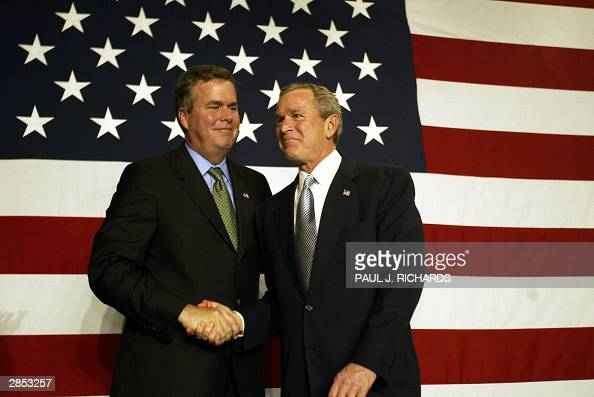 President George W Bush shakes hands with his brother Florida Governor Jeb Bush during a fundraising event at the PGA National Resort Spa in Palm...