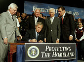 S President George W Bush signs the Homeland Security Appropriations Act of 2004 from Secretary of Homeland Security Tom Ridge as he is introduced at...