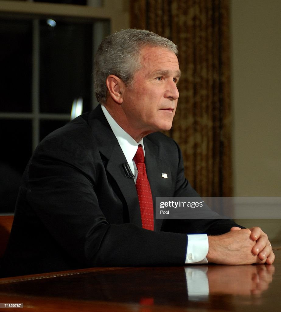 U.S. President George W. Bush sits at his desk in the Oval Office of the White House after addressing the nation on the anniversary of the 2001 terrorist attacks September 11, 2006 in Washington, DC. It's been five years since terrorists seized four airliners in flight, crashing two in the World Trade Center in New York, one into the Pentagon in Arlington, Virginia and one into a field in Shanksville, Pennsylvania.