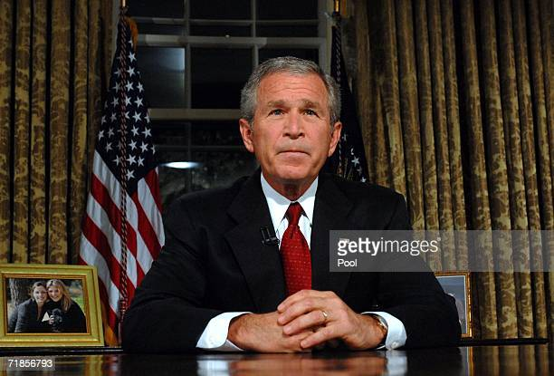US President George W Bush sits at his desk in the Oval Office of the White House after addressing the nation on the anniversary of the 2001...