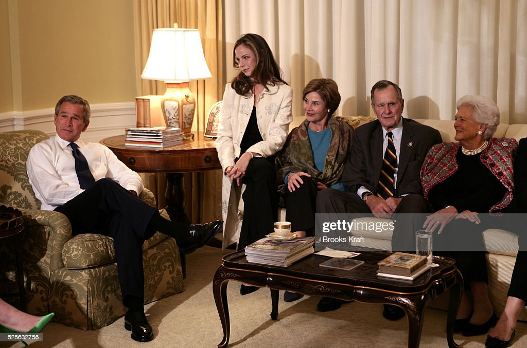 President George W Bush sits with family members as they watch election return in the White House on Tuesday November 2 2004 in Washington DC With...