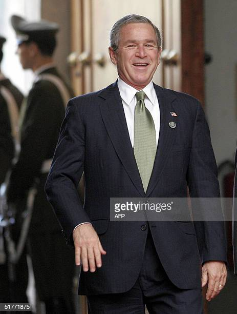 President George W Bush smiles as he arrives at the La Moneda Palace in Santiago 21 November 2004 Bush and the leaders of the 21 member countries are...