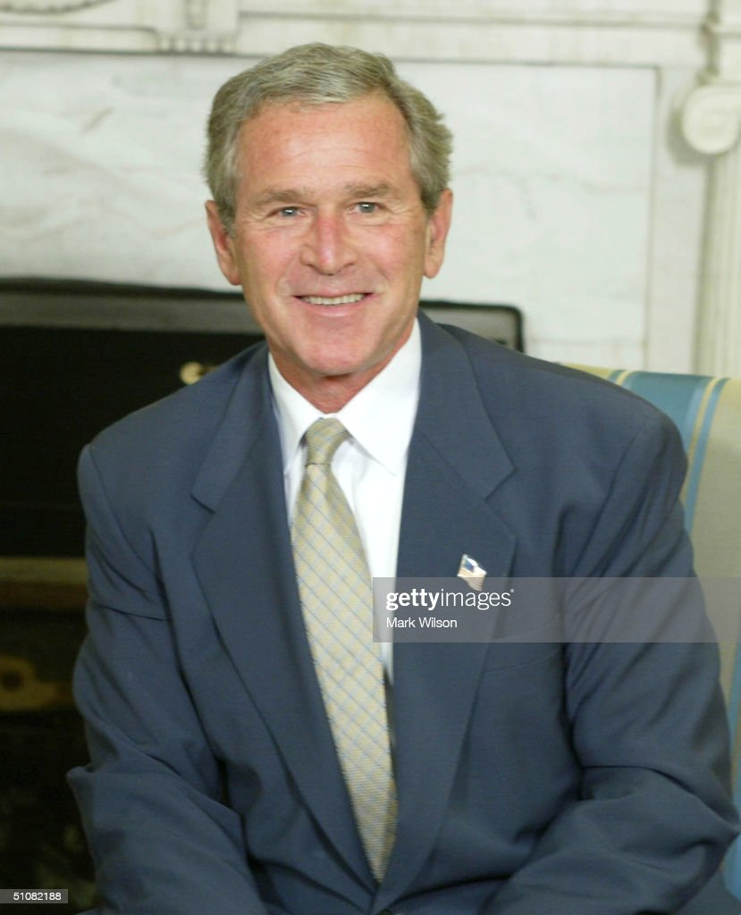 U.S. President <a gi-track='captionPersonalityLinkClicked' href=/galleries/search?phrase=George+W.+Bush&family=editorial&specificpeople=122011 ng-click='$event.stopPropagation()'>George W. Bush</a> smiles during a meeting with President Ricardo Lagos of Chile in the Oval Office at the White House July 19, 2004 in Washington, DC. The two leaders discussed relations between the two countries.