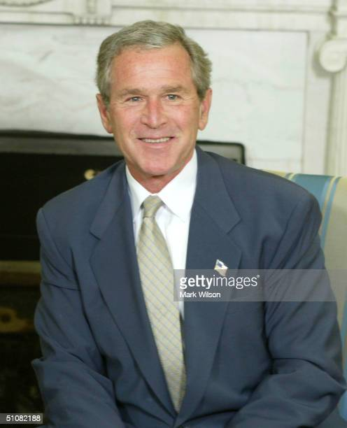 S President George W Bush smiles during a meeting with President Ricardo Lagos of Chile in the Oval Office at the White House July 19 2004 in...