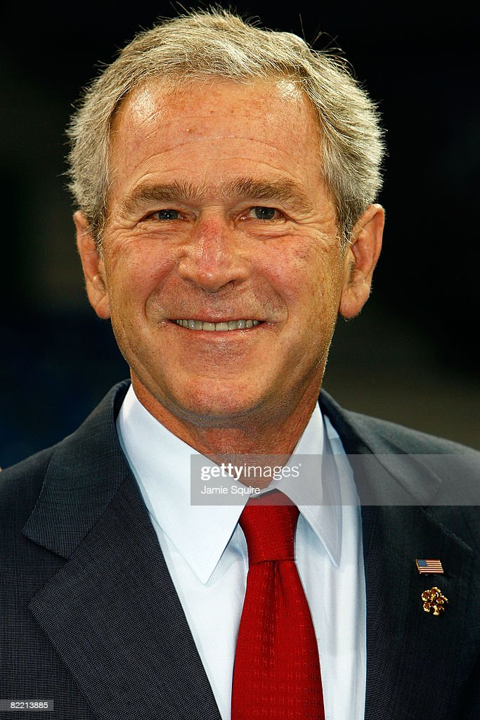 US President <a gi-track='captionPersonalityLinkClicked' href=/galleries/search?phrase=George+W.+Bush&family=editorial&specificpeople=122011 ng-click='$event.stopPropagation()'>George W. Bush</a> smiles during a meeting with the United States of AMerica Olympic team prior to the Opening Ceremony of the Beijing 2008 Olympic Games on August 8, 2008 in Beijing, China.