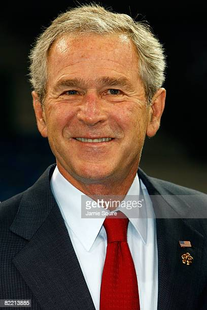 President George W Bush smiles during a meeting with the United States of AMerica Olympic team prior to the Opening Ceremony of the Beijing 2008...