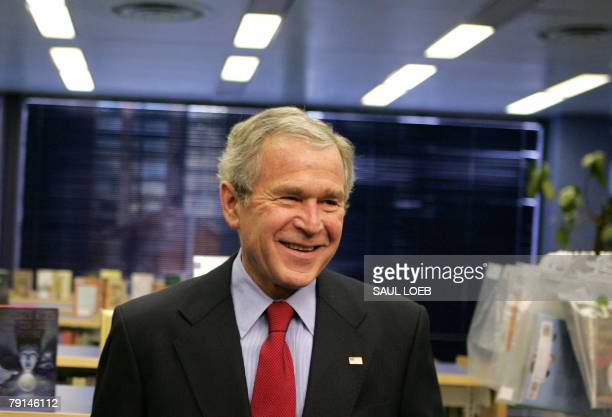 US President George W Bush smiles during a tour of the Martin Luther King Jr Memorial Library to observe Martin Luther King Jr Day in Washington DC...