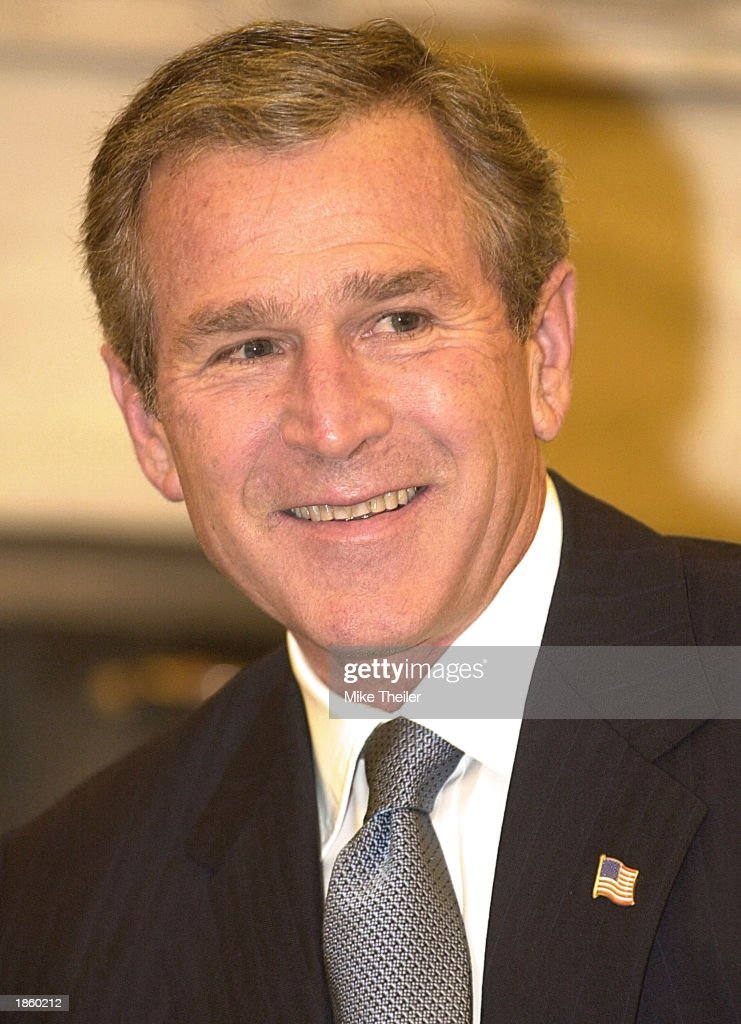 U.S. President <a gi-track='captionPersonalityLinkClicked' href=/galleries/search?phrase=George+W.+Bush&family=editorial&specificpeople=122011 ng-click='$event.stopPropagation()'>George W. Bush</a> smiles while sitting in the Oval Office of the White House March 20, 2003 in Washington, DC. President Bush earlier praised U.S. troops for their 'great skill and bravery' as military units crossed into Iraq and Baghdad faced a second night of bombing raids.