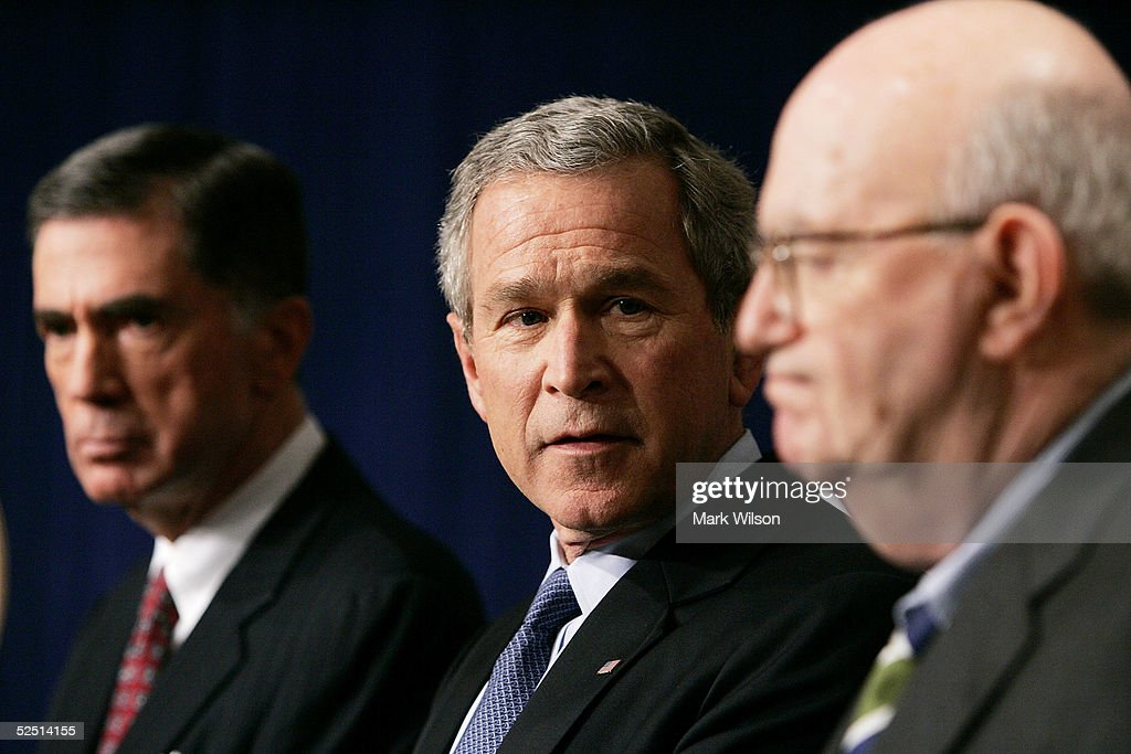 S President George W Bush speaks about a presidential commision's report on prewar intelligence regarding weapons of mass destruction while flanked...