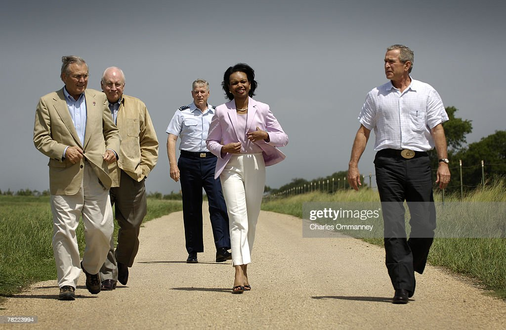 US President George W. Bush speaks alongside senior administration figures following their meeting on defense issues on his ranch August 11, 2005 in Crawford, Texas. Bush said on Thursday the decision of the U.N. nuclear watchdog to call on Iran to halt sensitive atomic work was 'a positive first step'. Pictured (L-R) behind Bush are National Security Advisor Stephen Hadley, Chairman of the Joint Chiefs of Staff General Richard Myers, US Vice President Dick Cheney, Secretary of State Condoleezza Rice and Defense Secretary Donald Rumsfeld.
