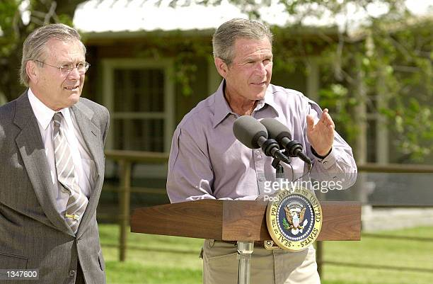 S President George W Bush speaks as US Secretary of Defense Donald Rumsfeld stands nearby after a morning defense meeting with white house advisors...