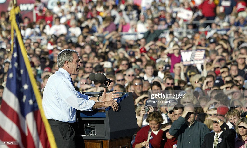 US President George W. Bush speaks at a campaign rally stop 27 October, 2004, in Findlay, Ohio. Nearly two dozen Hispanic organizations endorsed Bush's reelection bid on Wednesday. The Latino Coalition, a public policy research organization, and 21 mostly business and professional groups announced their decision with six days to go before Tuesday's election pitting Bush against Democratic Senator John Kerry of Massachusetts.